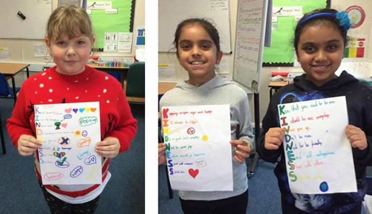 Day of Kindness pupils showing their work