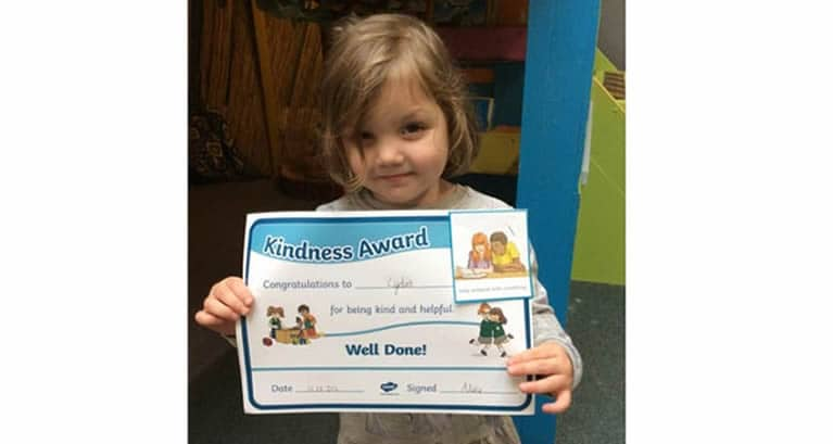 Day of Kindness pupil with certificate
