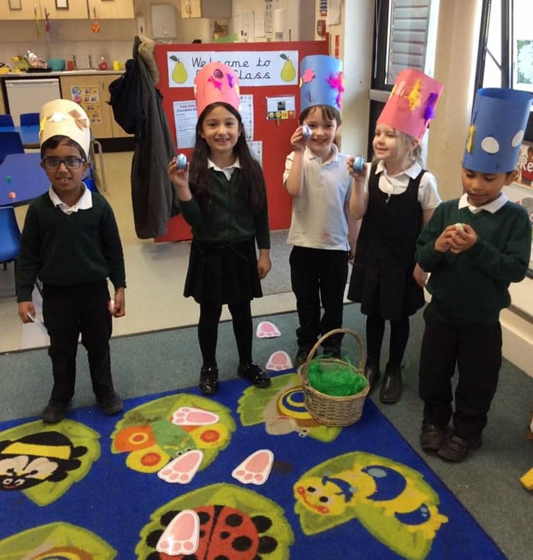 Children with their Easter eggs and hats